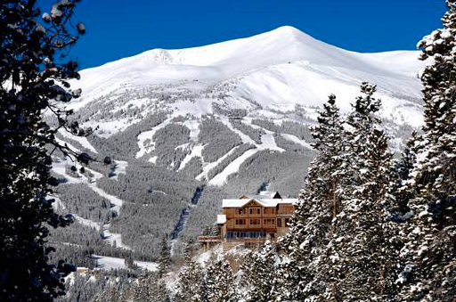 The Lodge and Spa at Breckenridge with a beautiful snowy scene in the background